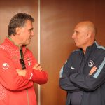 Old friends talking football