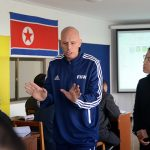 Delivering to the DPRK Coaches with the help Ms Kim Kun Hyang
