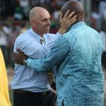 Being congratulated by the President of the Rwanda FA after beaing Congo