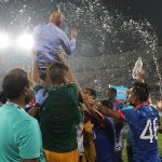 Players celebrating by throwing me in the air after winning the South Asian Cup