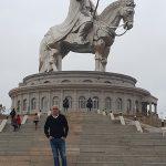 Below the great statue of Genghis Kann